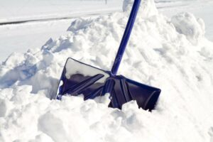 depositphotos_39410609-stock-photo-blue-snow-shovel-in-snow